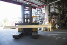 Hardware Store  Warehouse Worker Moving Planks In Fork Lift Truck