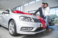 Man Looking At New Car With Re...
