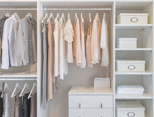 Fotomural  clothes hanging on rail in white wardrobe