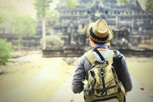 Young Traveler Wearing A Hat With Backpack And Tripod - At Angkor Wat, Siem Reap, Cambodia (very Soft Focus)