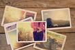 Travel photo album on wood table. instant photo of polaroid camera - vintage and retro style