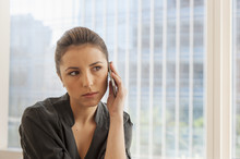 Unhappy Businesswoman Using Ce...