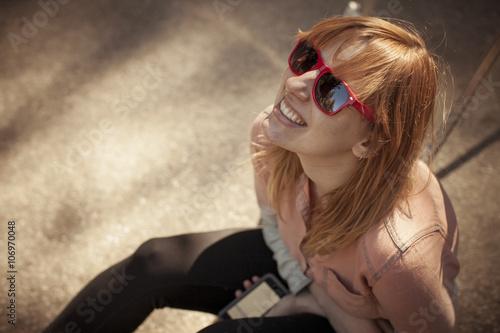 Candid portrait of mid adult woman in sunglasses gazing upward