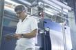 Engineer using digital tablet in power station