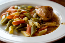 Colored Pasta With Chicken On Plate