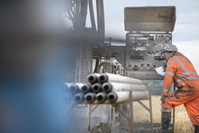 Drilling Rig Worker Inspecting Machinery