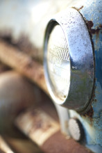 Side View Of Rusty Car Headlight And Bumper