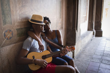 Young Couple Sitting With Mandolin