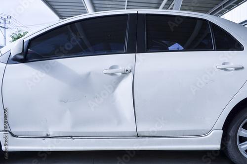 Fotografie, Obraz  White Car Body Get Damage on the door