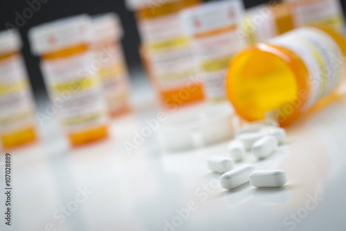 Medicine Bottles Behind Pills Spilling From Fallen Bottle