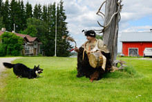 Sami Shaman And His Assistant - Dog. Finnish Lapland