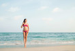 Hot girl wearing pink bikini on the summer beach