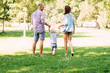 Parents having a walk with their son in the park