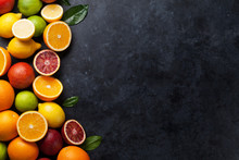 Fresh Citruses On Dark Stone