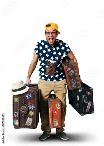 Foto  Tourist on vacation with a bunch of old suitcases