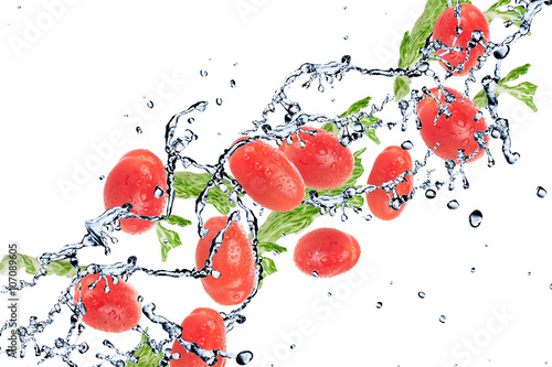 Keuken foto achterwand Opspattend water salad with tomatoes isolated on white background and Splashing water