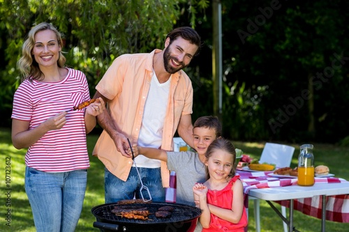 Papiers peints Grill, Barbecue Family cooking food on barbecue grill at yard
