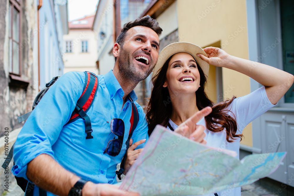 Fototapeta Young happy couple on a sightseeing tour in Europe