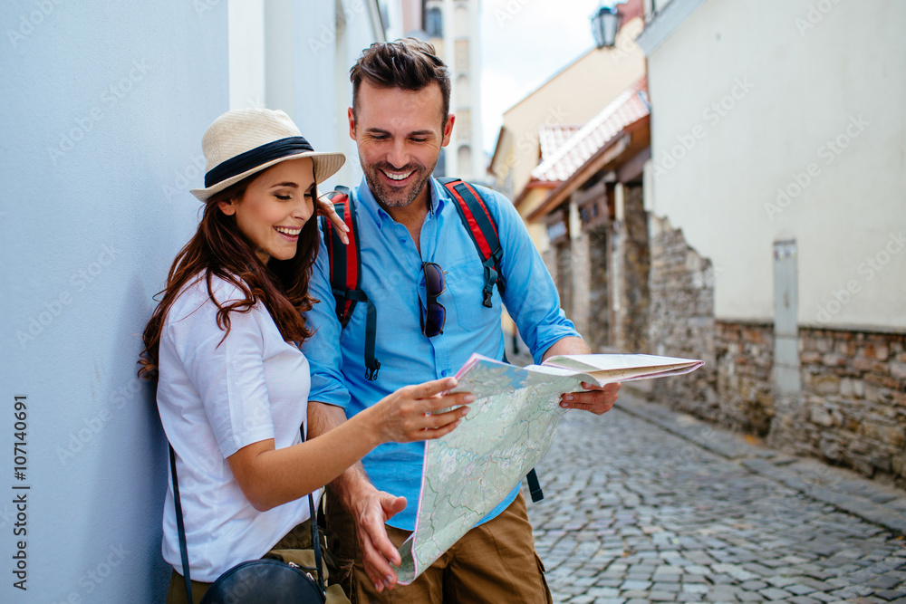 Fototapeta Tourists with map sightseeing city