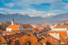 Kamnik, Slovenia - January 25, 2016. Red Roofs Of Old Part Of Town Kamnik View With Kamnik-Savinja Alps On The Background.