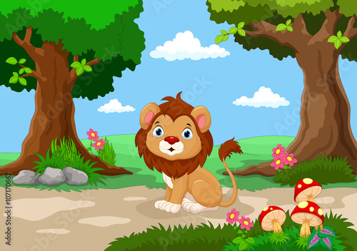 Funny baby lion sitting with a background of a beautiful garden