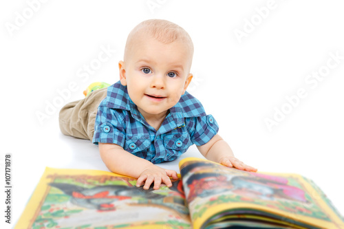 Smart Little Baby Boy In Shirt Reading A Book On The Floor