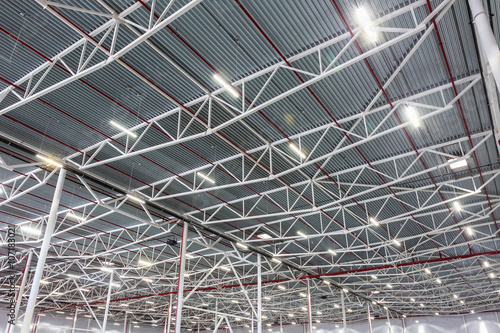 Slika na platnu ceiling lamps with diode lighting in a modern warehouse
