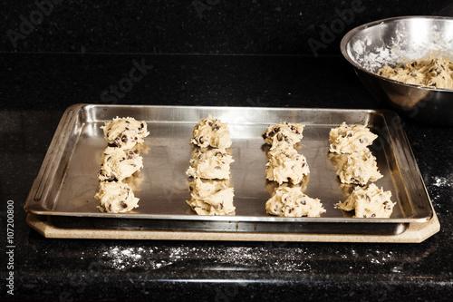 Valokuva  Balls Of Chocolate Chip Cookie Dough On Baking Sheet