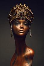 Female Mannequin In Golden Crown