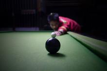 Man Shot  In Black Snooker Ball In Dark Tone