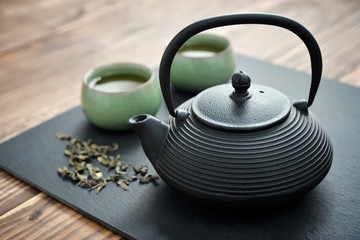Fototapeta Herbata Green tea in cast-iron teapot