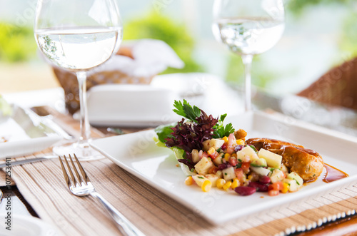 close up of food and water glasses at restaurant - 107253441
