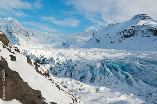 Poster Glaciers Svinafellsjokull glacier tongue in winter, blue ice covered by snow, Iceland