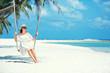 Beautiful woman swinging on a Tropical beach, Koh Phangan island. Thailand.