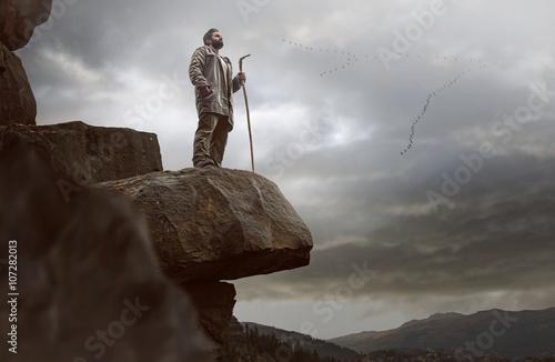 Obraz na plátně Lonesome Wanderer on a Rock