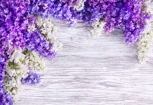 Fotobehang Lilac Lilac Flower Background, Blooms Pink Flowers on Wood Plank