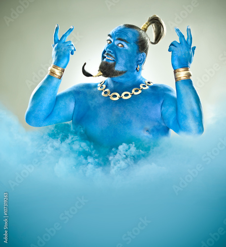 Foto genie of the lamp with smoke isolated on grey