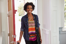Young Black Woman Arriving Home