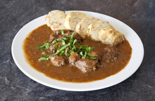 Czech Traditional Recipe For Beef Goulash With Homemade Dumpligs, Served In Simple Rustic Style