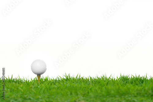 Spoed Foto op Canvas Golf Golf ball on green grass isolated on white background