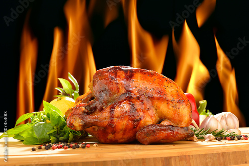 Fotobehang Kip Roast chicken and various vegetables on a chopping wood