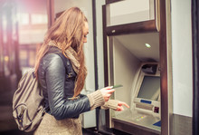 Young Woman Withdrawing Money ...