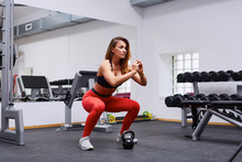 Woman Doing Squat Exercise At ...
