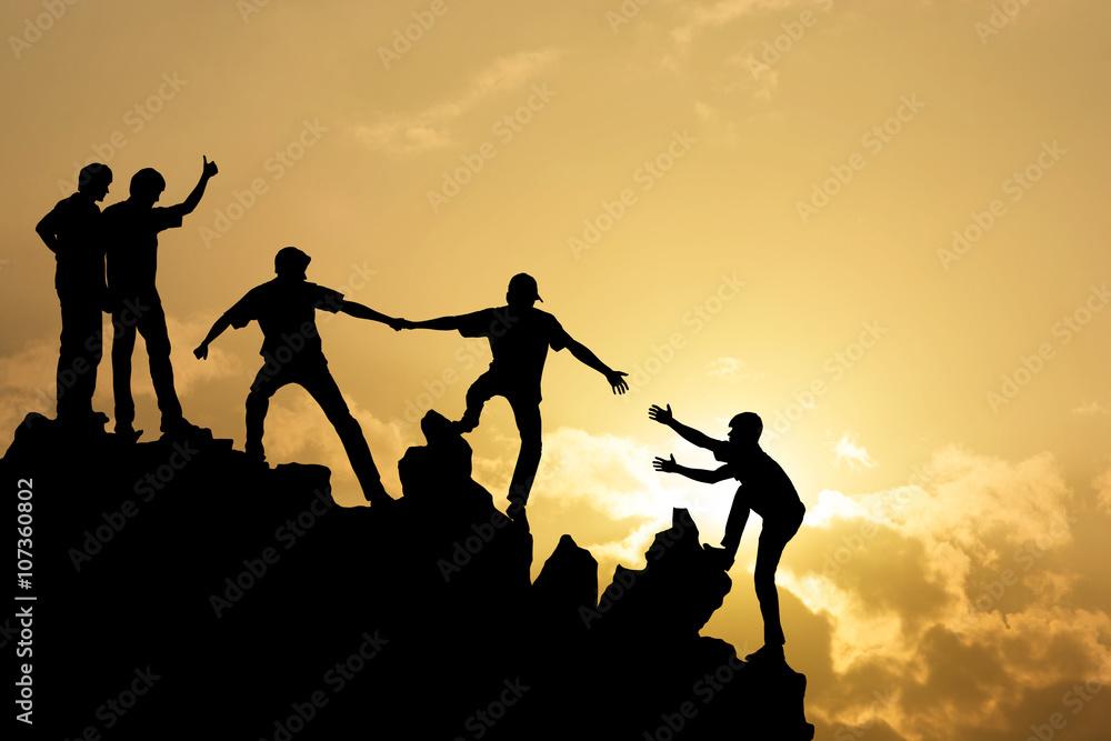 Fototapeta Group of people on peak mountain  climbing helping team work , s