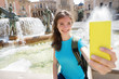 Girl tourist using smart phone camera to take photo while traveling in Valencia, Spain. Travel and tourism concept.
