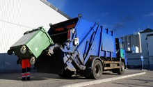 Garbage Transport Car Loading Itself In Port. Landfill Site, Ecology, Environmental Damage, Pollution, Infrastructure, Industry, Special Equipment, Reuse, Recycle, Zero Waste Concept. Sweden