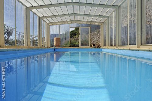 Swimming pool under a shelter at a mountain home, Provence, South of ...
