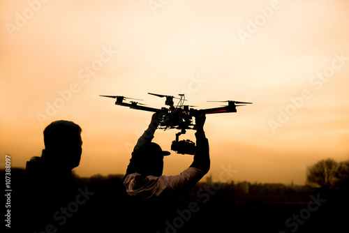 Man holding the drone, preparing for take off Canvas Print