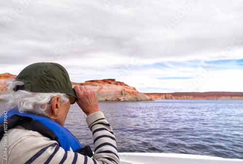 Fotografie, Obraz  Active senior out on a boat wears a hearing aid