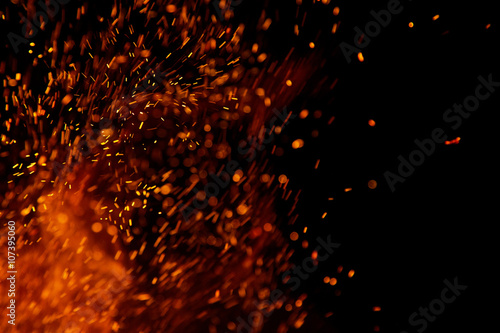 Papiers peints Feu, Flamme fire flames with sparks on a black background